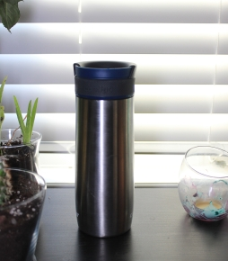 Silver 16 oz Contigo take-out mug on a desk.