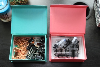 Boxes holding paper clips and letters