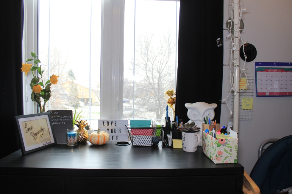 Organized desk in front of window