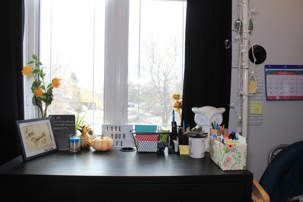 Organized desk in front of window
